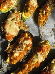 Baked aubergine stuffed with roast pumpkin, feta & walnut with minted courgettes